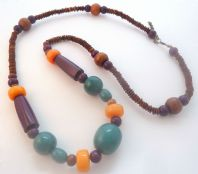 Long Length Chunky Seed And Wood Bead Statement Necklace.